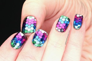 Hand-placed large hex glitter for sparkly rainbow fish nails!   See this post for the full details: http://www.polishallthenails.com/2013/01/true-rainbow-fish-nails.html