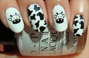 More photos here: http://www.swatchandlearn.com/nail-art-cow-nails/