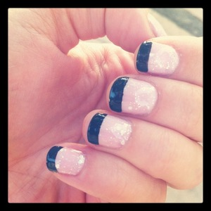 Gel nails! Actually regular nails with a gel topcoat :P http://monrogue.com/pink-sparkle-gel-nails-with-black-tips/