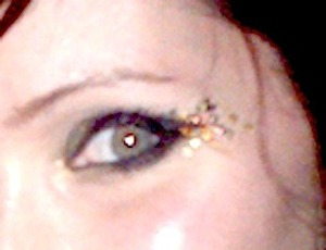 This was my New Year's Eve look, welcoming 2012 with ultra black eye make-up and multi colored gold leaf.  Please excuse the image quality... it had to be cropped from a regular picture rather than being photographed for its own sake. I guess I was too fo