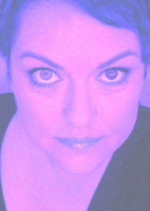 Me, testing out a brown contact lens on my blue eyes. Freaky!