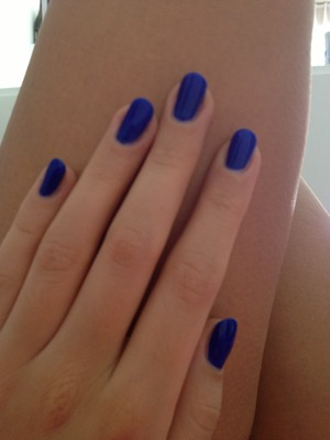 It's a dark glowing blue from Claire's :)