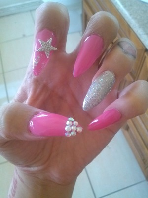 W a Stiletto nails w real girly design, i used crystals, china glace and glitter