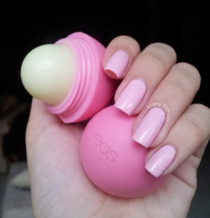 Holding an eos strawberry sorbet lip balm. For the swatch of this color, visit: http://www.beautylish.com/f/ncvrgx/jenna-hipp-damage-control-