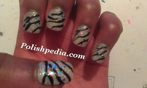 Danielle posted this design on our website.  Check it out @ http://polishpedia.com/shiny-zebra-print-nails.html