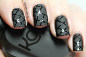 Painted base with Illamasqua Boosh, used striping tape for the pattern, painted over with Knock Out Flatte Black