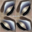Dark blue cut crease and pale gold lid