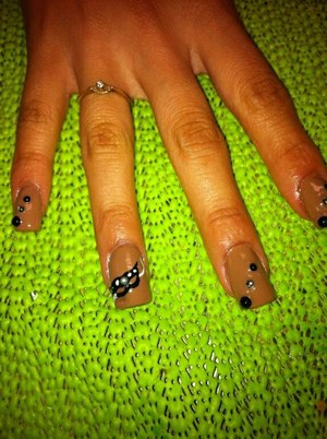 Masquerade mask with black and silver rhinestones on each nail.