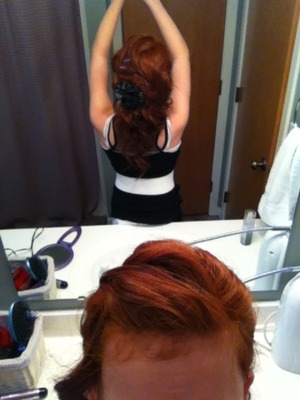 Big, bouncy curls pulled back into a half up half down updo with only some bobby pins and a curling iron(;