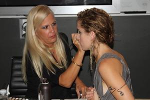 I always look sooooooooooooo serious when I work... Me doing singer Candi Lynn's makeup