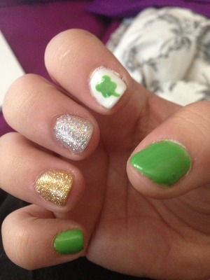 At pattys nails with a clover, green and glitters