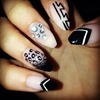 Black and stones nail design