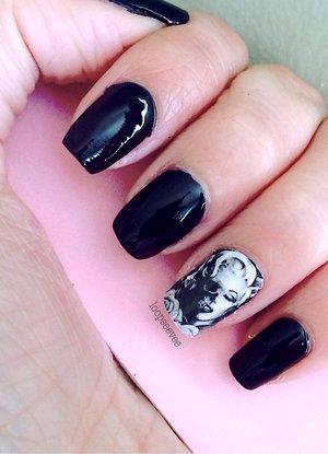 •Black & white half Marilyn and skull face stickers.  •Black santee nail polish.