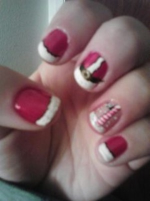 santa claus inspired nails with north pole on ring finger