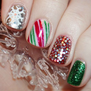 This is the Christmas mani I rocked during the festivities!  I used A TON of polishes and products for this design so please read my blog post to see what polishes I used before asking questions. They are all listed over there.
