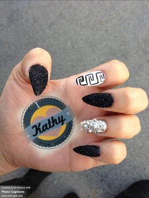 Black and white pattern with black glitter stiletto nails