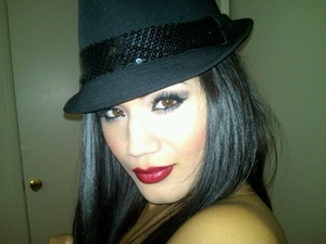 Silver Smokey eye with cherry red lips topped off with a sequined fedora. Oh yes!