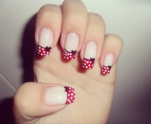 Red tips with white polka dots. Little black bow on each nail. Minnie mouse.