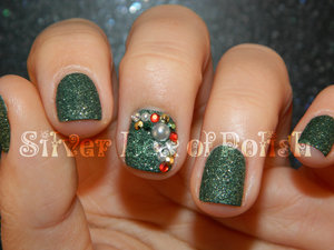 Christmas nails with textured polish and studs, rhinestones, and pearls.