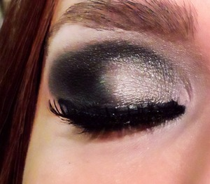 Hello! This is a beautiful look that I did for Fashion Week. I used Blackout and Creep on the outer corner and Gunmetal applied with a moist brush. Then I used a Highlighting pencil under my eyebrow...Used a black gel liner and some eyelashes from Ardell! Hope you like!