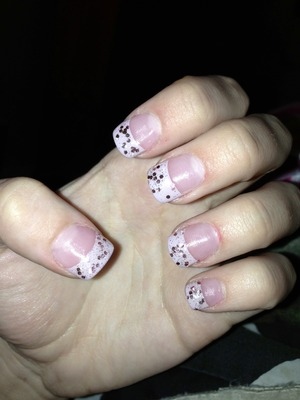 this is an OPI pastel pink color with a new OPI glitter paint over it. I thought this was good for winter or early spring or easter!