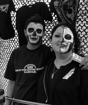 I did not do this make up. This is at a Dia De Los Muertos festival, these two did a great job.