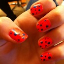 Neon pink with navy polka dots