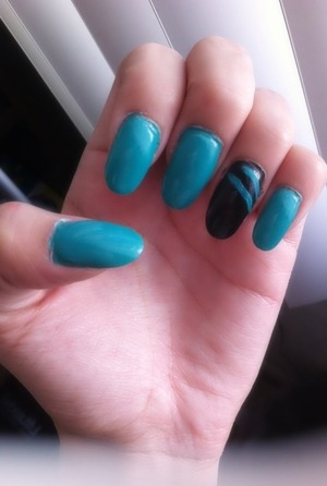 "Opi - ""Black Onyx"" & essie "" naughty nautical "" 💙 lol I'm not very good but oh well ✌☺"