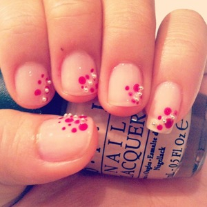 coat your nails then use the dotting tool to make some little dots and put some small beads on. Voila!