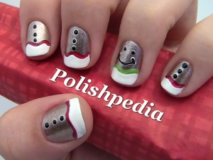 I love making gingerbread men during the holidays...on my nails!  Watch My Video Tutorial @ http://polishpedia.com/gingerbread-man-christmas-nail-art.html