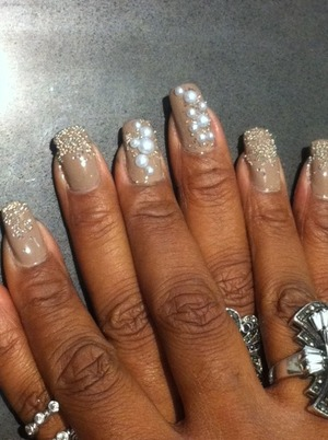 Opaque nude color sprinkled with silver and white nail caviar with flat back decorative pearls