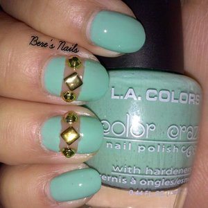 teal nails for a base and accented two with a cutout design. added round and square gold studs!