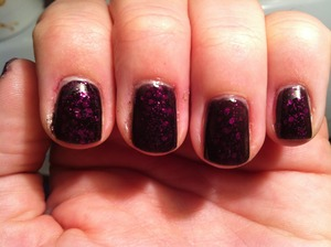 Not sure why, but this revlon polish can be found under both of these names. Beautiful sheer black jelly base with at least 2 sizes of fuschia glitter. Goes on very well.