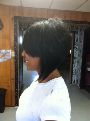 Brooke has a long side bang, hair layered on the top, with a long assymetrical swing on one side and a short cut on the other.