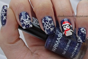 Tutorial on : http://claudiacernean.blogspot.ro/2013/12/unghii-cu-pinguin-penguin-nails.html