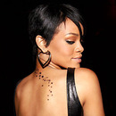 Music Artist Rihanna with Stars on her back