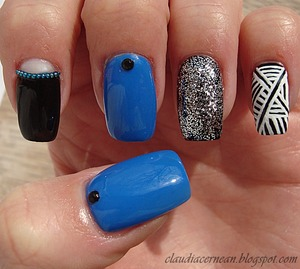 Tutorial on : http://claudiacernean.blogspot.ro/2013/03/unghii-aztec-aztec-nails.html