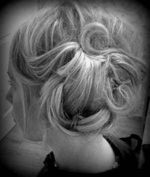 Heated rollers used as a base, clip in hair extensions already curled and then interlocked and pinned