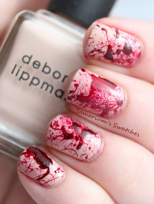 http://samariums-swatches.blogspot.com/2012/06/true-blood-celebratory-splatter-mani.html?ref=nf