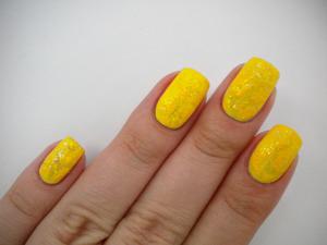 http://missbeautyaddict.blogspot.com/2012/03/31-day-challenge-yellow-nails-essence.html