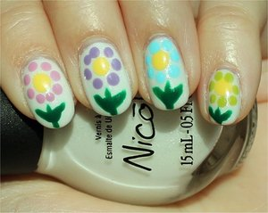 Spring Flower Nails http://www.swatchandlearn.com/blog-news-my-guest-post-on-chitchatnails/