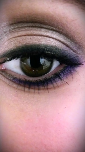 A subtle smokey look with a pop of purple