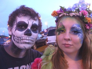 I was pregnant for Halloween this year so I had to create a costume around my belly. I'm  mother earth and Tim is just a skull man.