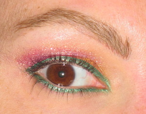 Gold in the corner, purple in the center and pink on the outter corner. Stila liquid liner all the way around.