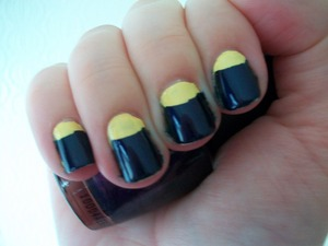 Yellow & Blue Half Moon Manicure Using China Glaze Lemon Fizz & OPI Russian Navy  To read about how I did this manicure please visit my blog:  www.mazmakeup.blogspot.com