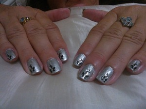 After cuticle care, buff & file I applied Ulta3 Nail Colour Base Coat & 2x coats of Revlon Nail Enamel Silver Screen, once dried I applied a top coat by Revlon adding the nail stickers