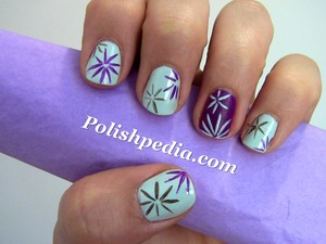 All the blooming beauty this spring has inspired me to do these nails.  Watch The Video Tutorial @ http://polishpedia.com/spring-flowers-nail-art.html