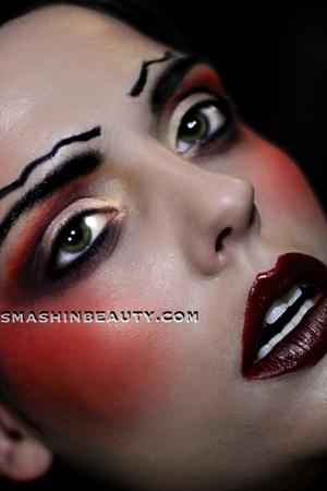 more info:  http://smashinbeauty.com/dramatic-fantasy-makeup-2012/