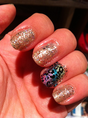 OPI Spark De Triomphe with OPI Servin' Up Sparkle. Ring finger is the Lisa Frank Leopard Print nail that SayAnythingBr00ke did as a tutorial like 2 years ago. This was JUST after I painted it. Sorry it's still messy :)