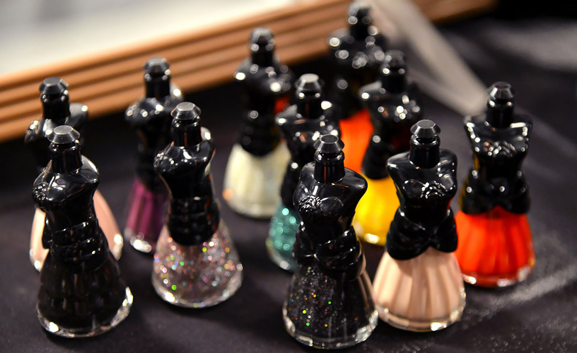 Anna Sui nail polishes backstage at Anna Sui Spring 2013  | Photo: Mike Coppola/Getty Images